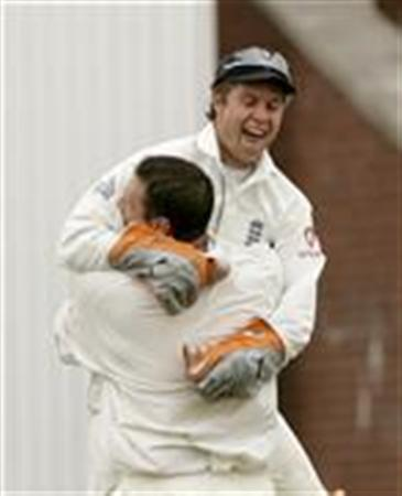 England players Jones and Harmison celebrate after dismissing Pakistan's Razzaq to clinch victory on the third day of their second test cricket match in Manchester